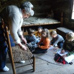 On a field trip - inside the Log Cabins