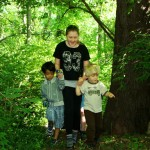 School outdoors - primary and elementary children on a woodland trail